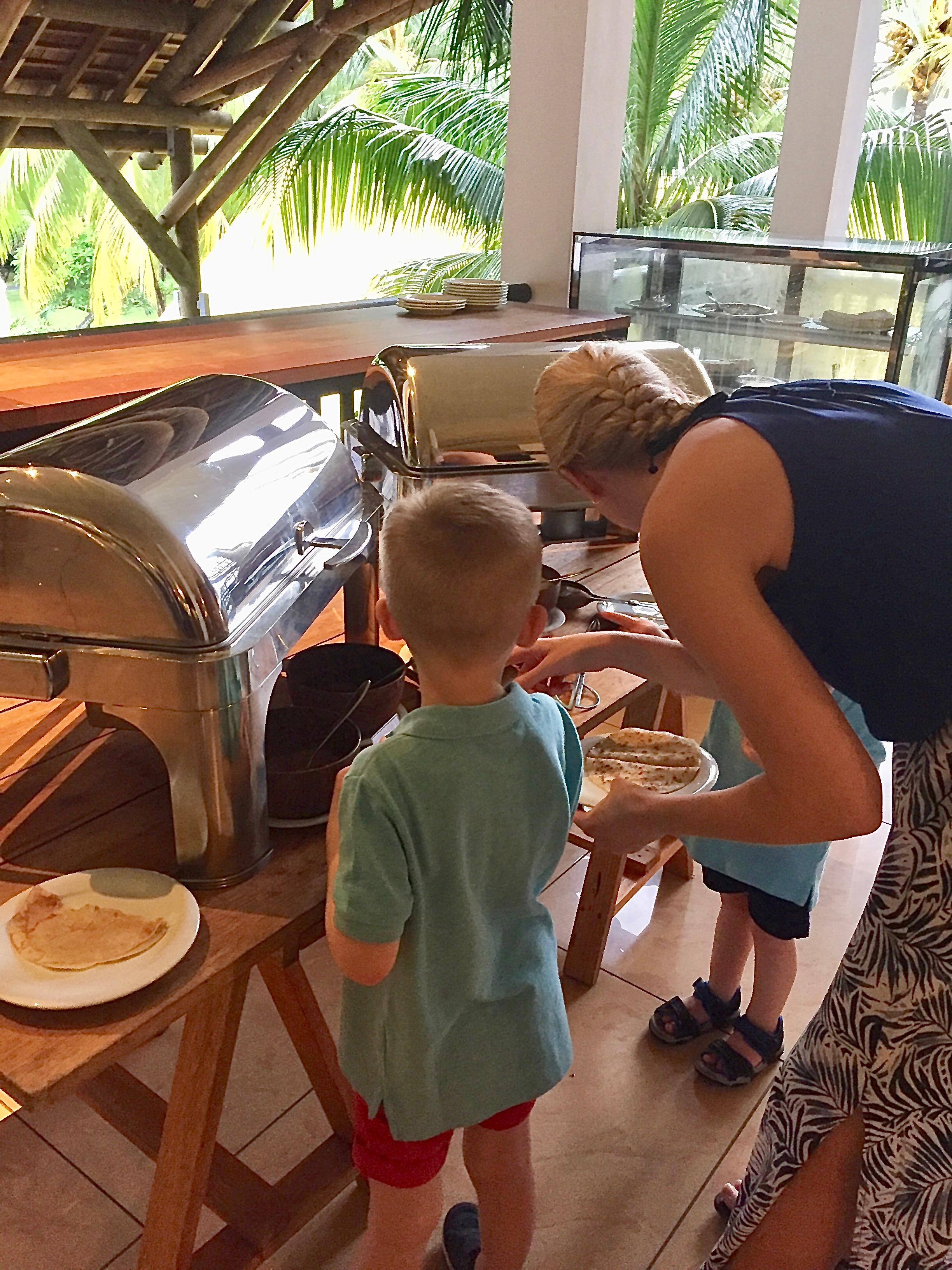 Children eat pancakes at Ravenala Attitude