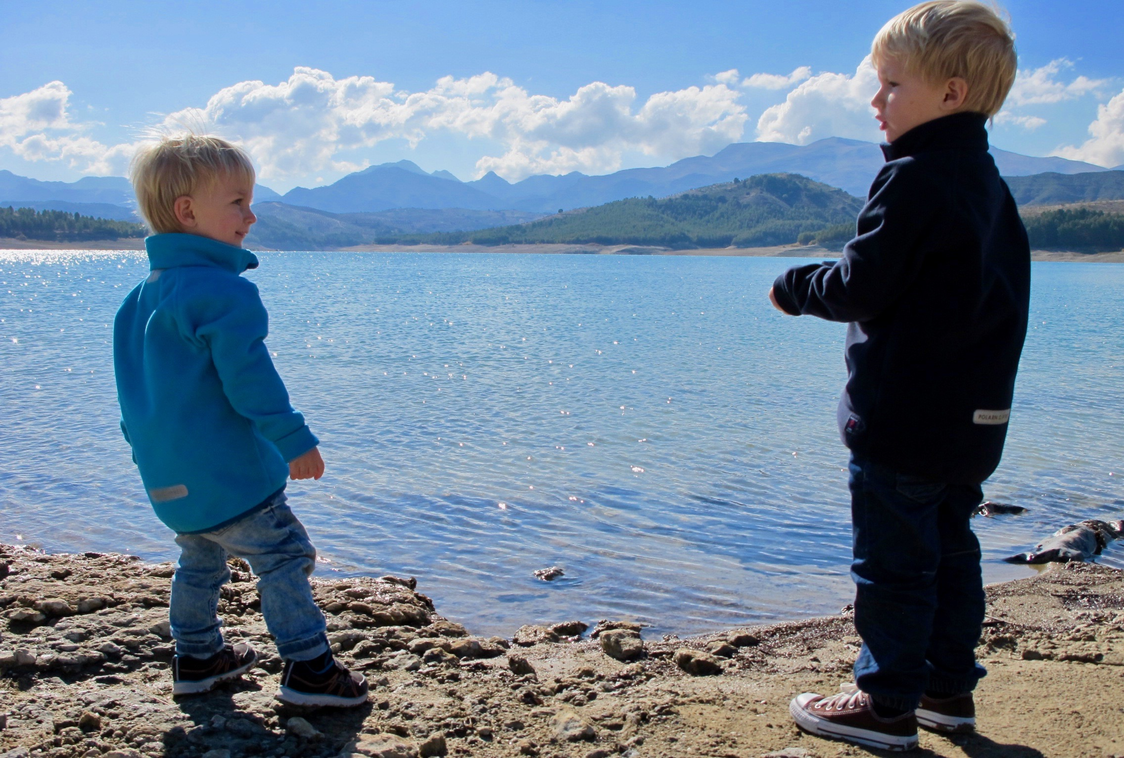 The children play beside the lake Los Bermejales